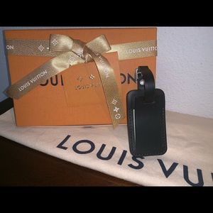 Authentic Louis Vuitton black horizon luggage tag